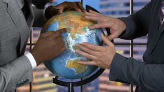 Hands of men touch globe. Two adult businessmen. Discussion of scientists. What future awaits the Earth.