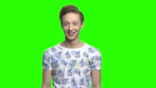 Happy boy showing two thumb up signs. Green screen hromakey background for keying.