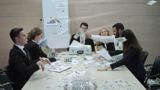 Happy businessmen are scatter dollars. Successful business deal. Businessmen in a meeting room.