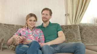 Happy caucasian couple indoors. Man and woman smiling.