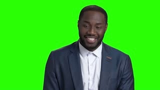 Happy confused afro-american businessman. Smiling joyful businessman receiving compliments on Alpha Channel background. Pleasant surprise concept. Unexpected happy news.