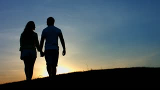 Happy ending . A date at sunset. Love story. Lovers walk in the mountains. Evening walk in love couple.