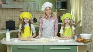 Happy female chef and children. People showing thumbs up.