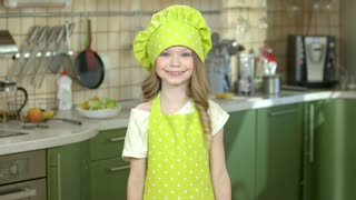 Happy girl with kitchen utensils. Smiling child wearing chef uniform. Skills every cook should know.