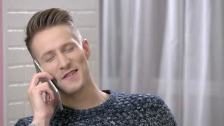 Happy man on the phone. Handsome caucasian male smiling. Mobile network operator advertising.