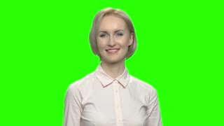 Happy mature business woman giving thumb up. Green screen hromakey background for keying.