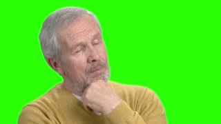 Happy thinking man, green screen. Mature man thinking with a smile and hand on chin, chroma key background.