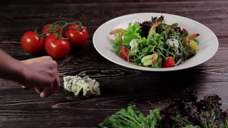 Healthy salad with shrimps, vegetables and cheese Dor Blue. Food style.