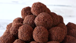 Heap of brown ball-shaped sweets. Chocolate gingerbread balls. Healthy and delicious cookies.