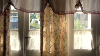 House doors from inside. Sunlight and curtains. Cozy house in countryside.