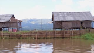 Houseboats. Huts on the water. Panorama of bamboo huts on the lake. Fishing houses on the water. Thatched roof. Inle Lake.