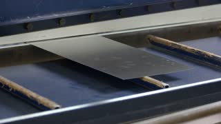 Hydraulic guillotine shear. Thin metal sheet.