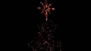Illumination of a star on top of a christmas tree. Flashing lights. Dark in the background.