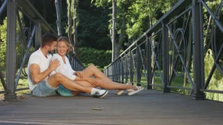 In love in a beautiful park. A date on the bridge. Love games. Happy lovers.