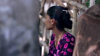 Indian woman sitting pensive and sad.