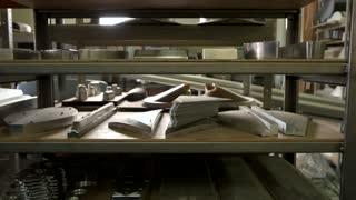 Industrial parts on shelves. New metal details.