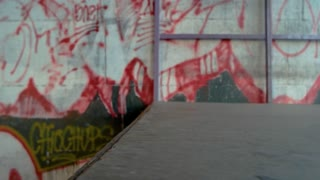 Inline skates in slow motion. Rollerblades and ramp.