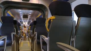 Inside modern passenger train. Train wagon seats. Fastest public transport.