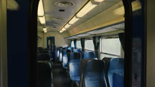 Inside passenger train wagon. Train seats and windows.