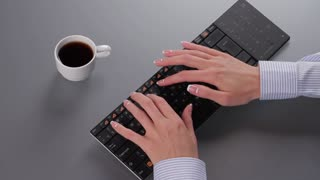 Intensive work schedule of business manager. Today it is necessary to have time to finish the job. Girl typing on computer and drinking coffee.