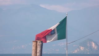 Italian flag on scenic background. Flag in the wind. Culture of Italy.