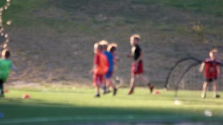 Kids on football training. Blurred background.