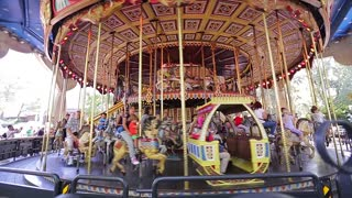 Kiev, Ukraine 21. 08. 2014. People with kids fun ride on the carousel. Retro carousel at an amusement park.