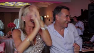 Kiev, Ukraine 25. 08. 2012. Emotional guests dance at the banquet. Friends having fun. Guests at the wedding. Funny guests.