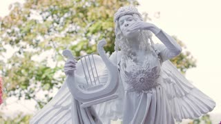 Kiev, Ukraine 25. 08. 2012. Living statue is moving before the public. Sweet angel.