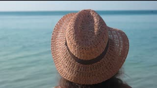 Lady in hat, sea background. Woman outdoors, summer.