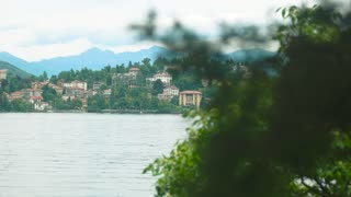 Lake Maggiore and Stresa town. Water, buildings and mountains.