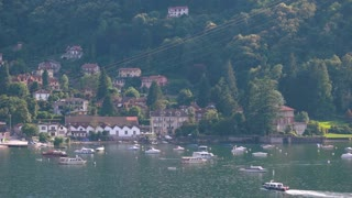 Lake Maggiore in summer bay. Town and nature, Italy.