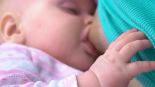 Little baby drinking from mother breast. Suckling baby infant. Mother nursing and feeding her baby close up. Breastfeeding tips concept. Basis of motherhood.