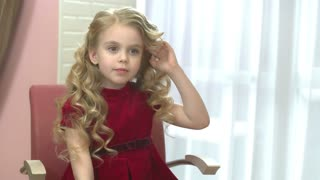 Little girl with beautiful hair. Caucasian child smiling indoor. Special occasion hairstyles for kids.