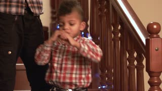 Little kid plays flute. Mulatto boy with music instrument. Melody of the holiday. Learn to improvise.