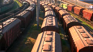 Long railway freight trains with lots of wagons. Top aerial view. Logistic and transportation concept.