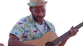 Macho plays the guitar. Guitarist plays guitar and sings. Mulatto sings with a guitar around the campfire. Rest at nature.