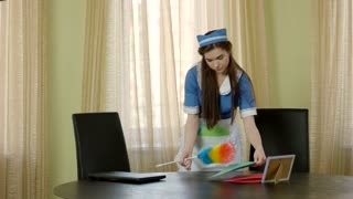 Maid with brush cleaning dust. Young caucasian female working. Employment outlook in hospitality industry.