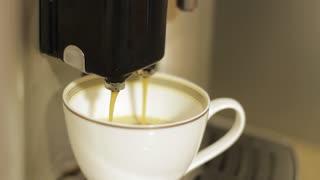 Making coffee. Coffee machine. Hot coffee.
