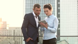 Man and businesswoman holding tablet. People on city background. Importance of common goals.