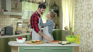Man and woman hugging, kitchen. Happy caucasian people. Start cooking as a family.