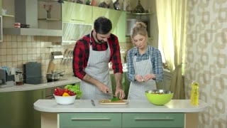 Man and woman, kitchen. Couple and vegetables. Cooking together on a date.