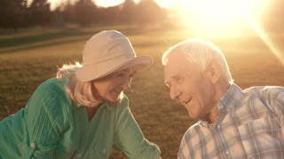 Man and woman on meadow. Smiling elderly couple. How to build better life. Hearts and smiles.