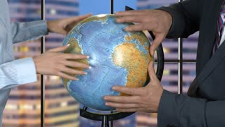 Man and woman touch globe. Businessman and young lady. Company must expand. Two heads better than one.