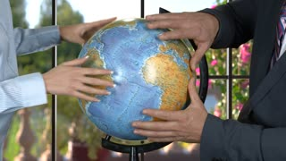 Man and woman with globe. Hands of caucasian business people. We can change the world. Great minds think alike.