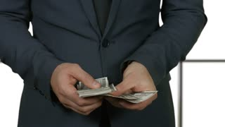 Man counting cash isolated. Businessman putting money into pocket. Build wealth on your own.