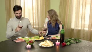 Man giving present to woman. Young couple having romantic dinner. Gifts to impress a girl.