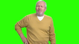 Man having problem with back. Unhappy senior man suffering from pain in his back, chroma key background.