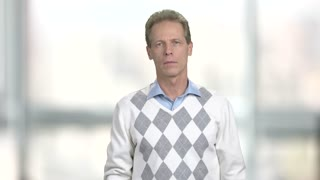 Man having sudden cough attack. Caucasian middle-aged man coughing on blurred background. How to stop cough attack.