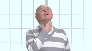 Man with sore throat and cough. Elderly man feeling pain in throat. Elderly sick man having cough.